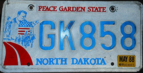 North Dakota State license plate blue letters on creme backround