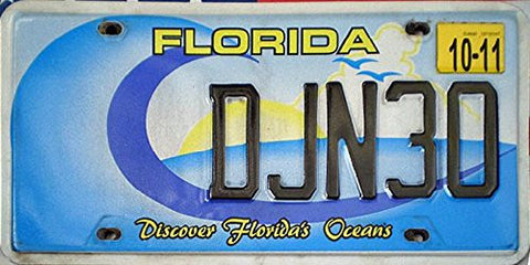 "Florida State License Plate "" Discover Floridas Oceans"" Black Letters on Blue White and Yellow Beach Backround"