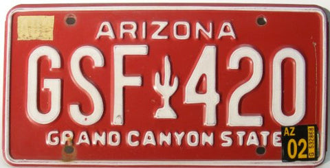 Arizona License Plate white numbers on red with white cactus