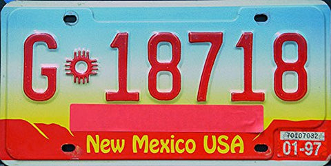 New Mexico USA State License Plate red numbers on blue yellow red with Indian symbol