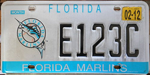 "Florida State License Plate "" Florida Marlins"" with Black Letters on White Backround and Marlins Logo with Slight Discoloration"