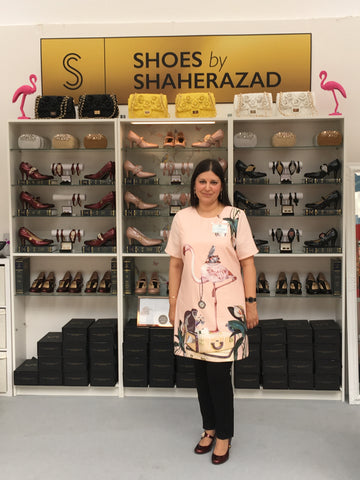 Shaherazad Umbreen wearing a flamingo print dress
