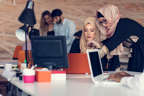 Two women in the office wearing hijab