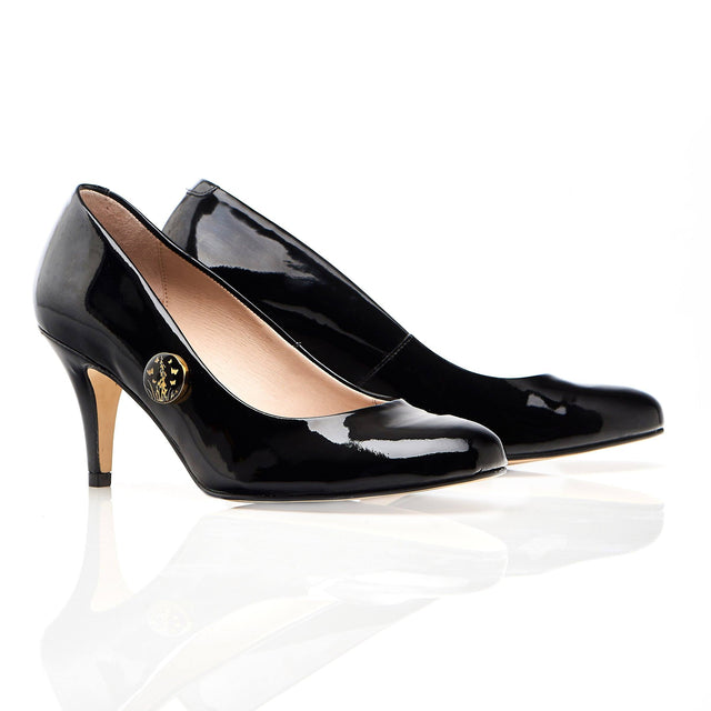 Black patent leather shoes with butterly