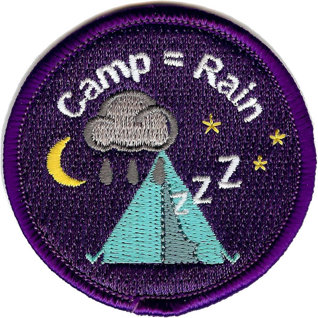 Embroidered circular badge with the words 'Camp = Rain'