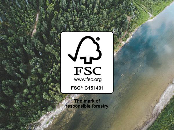 Image of the FSC Madovar label on top of a panoramic image of a forest