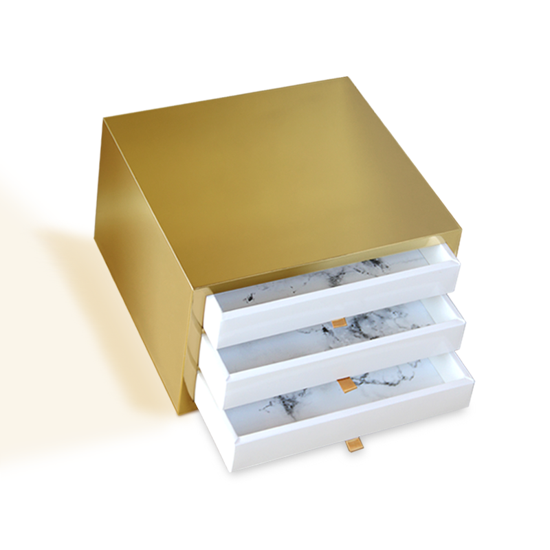 Handmade luxury drawer gift box with gold exterior, white trays with marble inserts and brownish ribbons