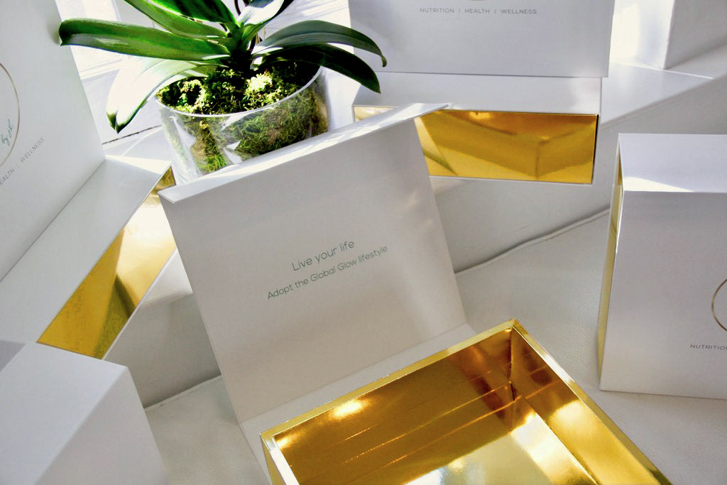 Madovar white outside, gold inside magnetic closure boxes with custom acetate reveal and custom printing for Global Glow products