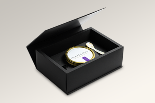 Madovar black magnetic closure box with custom insert that holds a caviar gift set