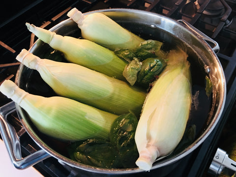 Par-cooked herb infused corn on the cob