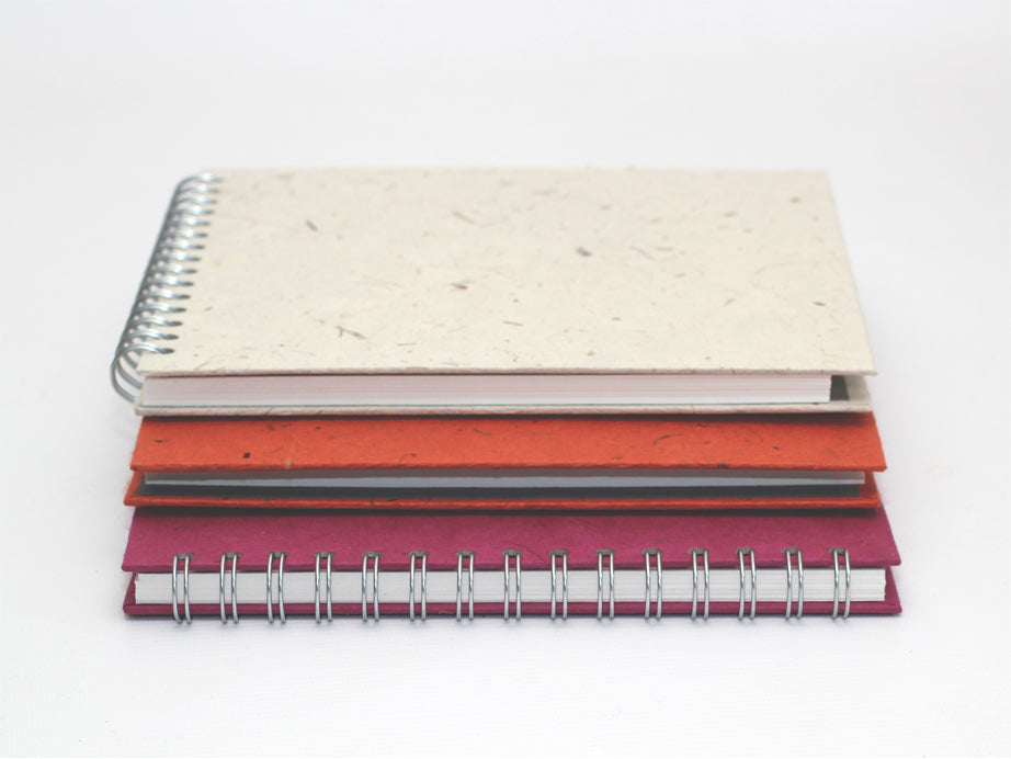 A pack of 3 square sketchbooks in assorted banana tissue paper covers.