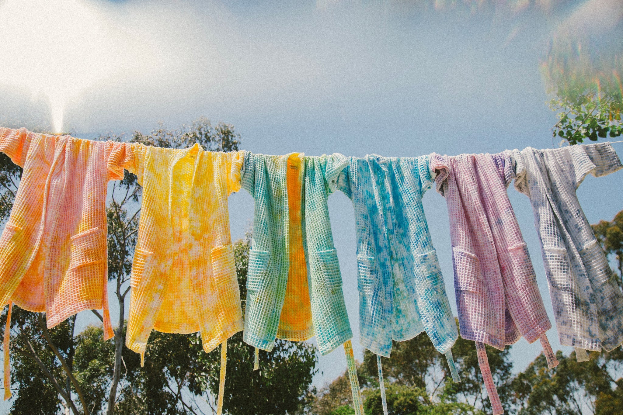 robes hanging on a clothesline