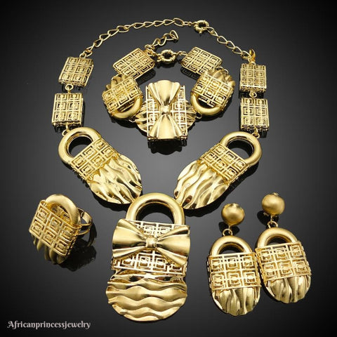 FOUR PIECE AFRICAN GOLD PLATED NECKLACE SET.