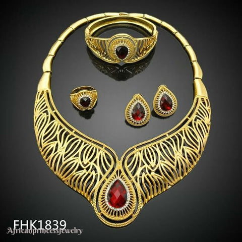FOUR PIECE AFRICAN GOLD PLATED NECKLACE SET