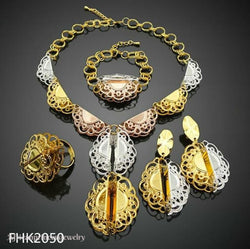 FOUR PIECE GOLD PLATED NECKLACE SET