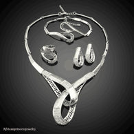 FOUR  PIECE 18K WHITE GOLD PLATED SILVER NECKLACE SET