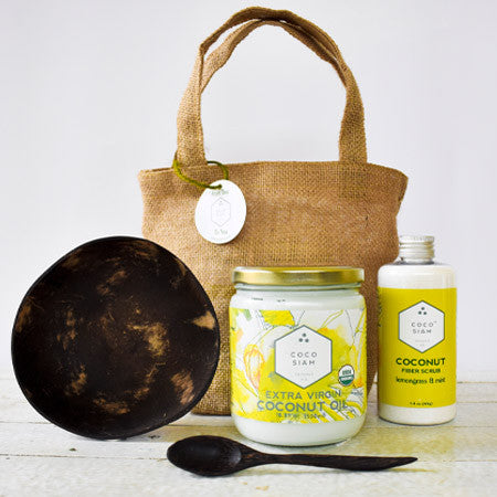 Coconut Oil gift set with a jar of coconut oil, coconut fiber scrub, coconut bowl, coconut spoon in a reusable brown bag