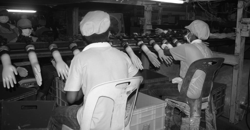 workers at a glove factory