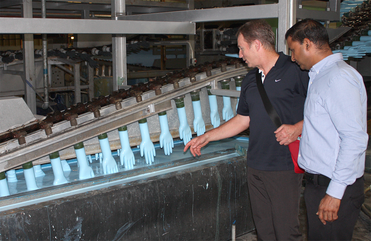 Steve viewing the manufacturing process at a glove supplier