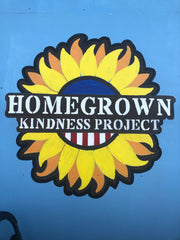 kindness project logo on wall