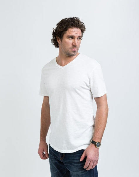 Drew V Neck in White is known for its relaxed fit and essential design.