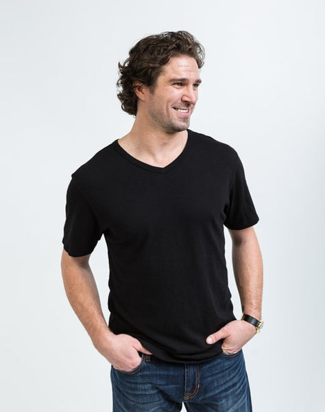 Drew V Neck in Black is known for its relaxed fit and essential design.
