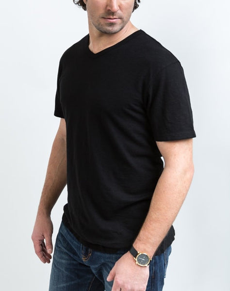 Side view of the Drew V Neck in Black which is known for its relaxed fit and essential design.