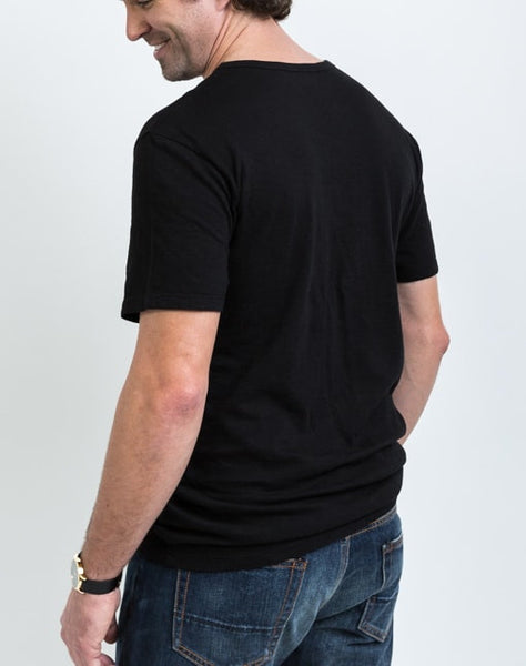 Back view of the Drew V Neck in Black which is known for its relaxed fit and essential design.