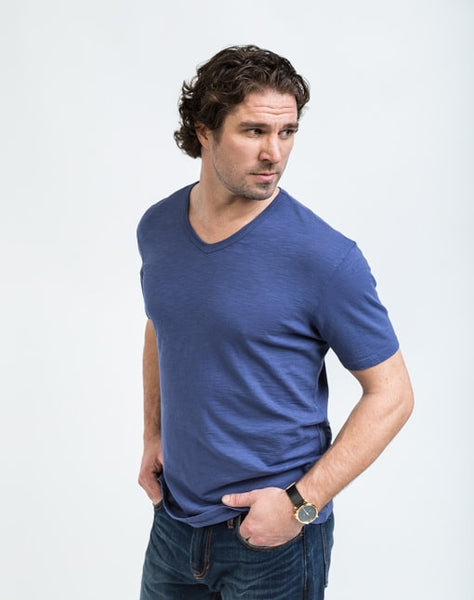 Drew V Neck in Naval is known for its relaxed fit and essential design.