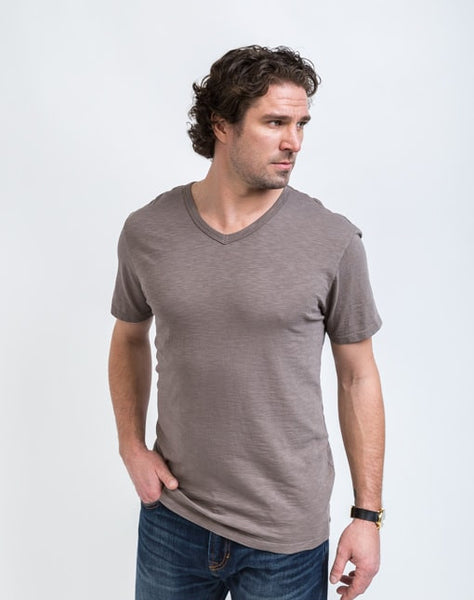 Drew V Neck in Peat is known for its relaxed fit and essential design.