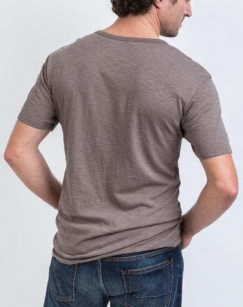 Back view of the Drew V Neck in Peat which is known for its relaxed fit and essential design.