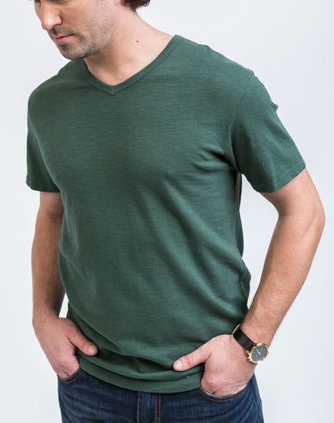 Side view of the Drew V Neck in Jungle which is known for its relaxed fit and essential design.
