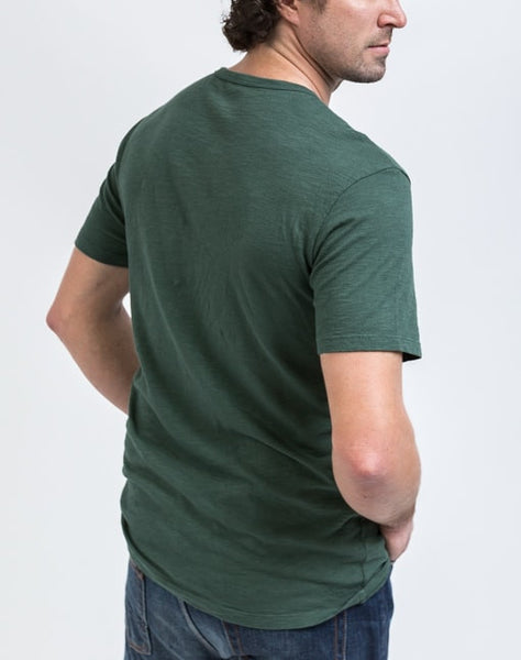 Back view of the Drew V Neck in Jungle which is known for its relaxed fit and essential design.
