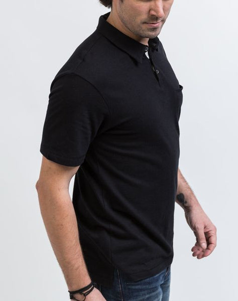 The side view of the Alex golf polo in black is known for its structure and good fit.