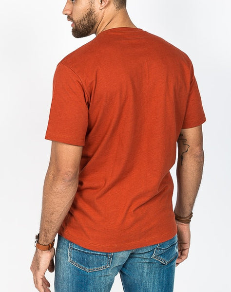 The Ethan crew neck in rust is known for its soft cotton brush jersey and timeless design.