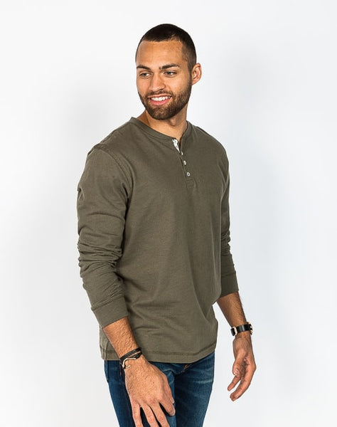 The Rob in olive is a timeless long sleeve henley that is known for its quality and comfortable cotton brushed jersey.