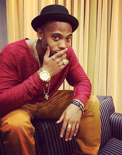 B.o.B wearing a King Ice necklace and crown ring.