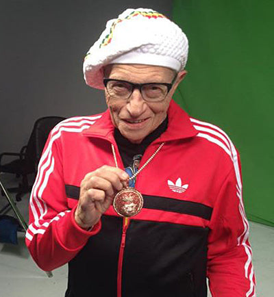 Broadcasting legend Larry King wearing a King Ice lion chain.