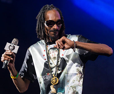 Snoop Dogg wearing King Ice jewelry during a performance.