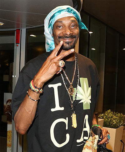Snoop Dogg out and about wearing a King Ice skateboard chain.