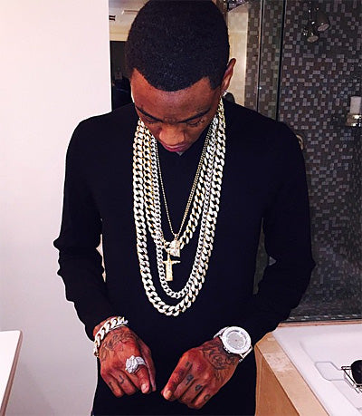 Soulja Boy wearing a King Ice Christ the Redeemer necklace.