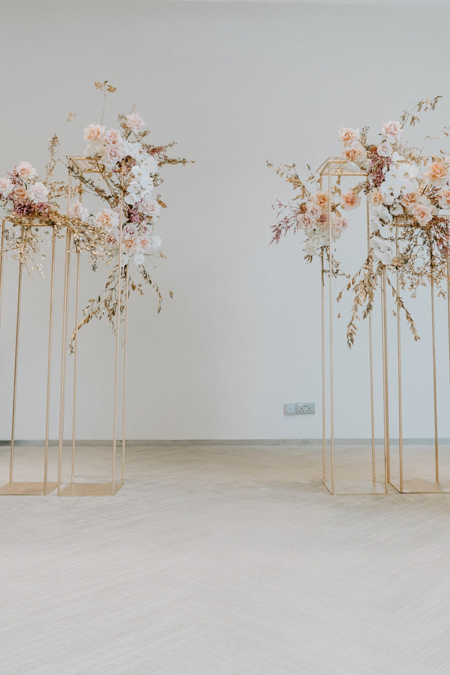 Gold minimalist standing flower installation for opening ceremony and wedding stage decor