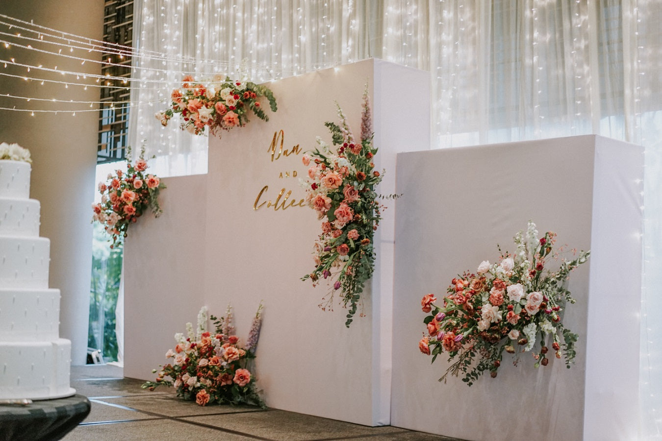 Floating flowers for wedding ceremony florals on main stage with cascading string lights