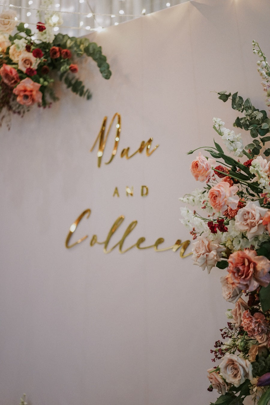 Close up of custom acrylic couple name in gold on white backdrop for wedding dinner at Park Royal Pickering Hotel Singapore