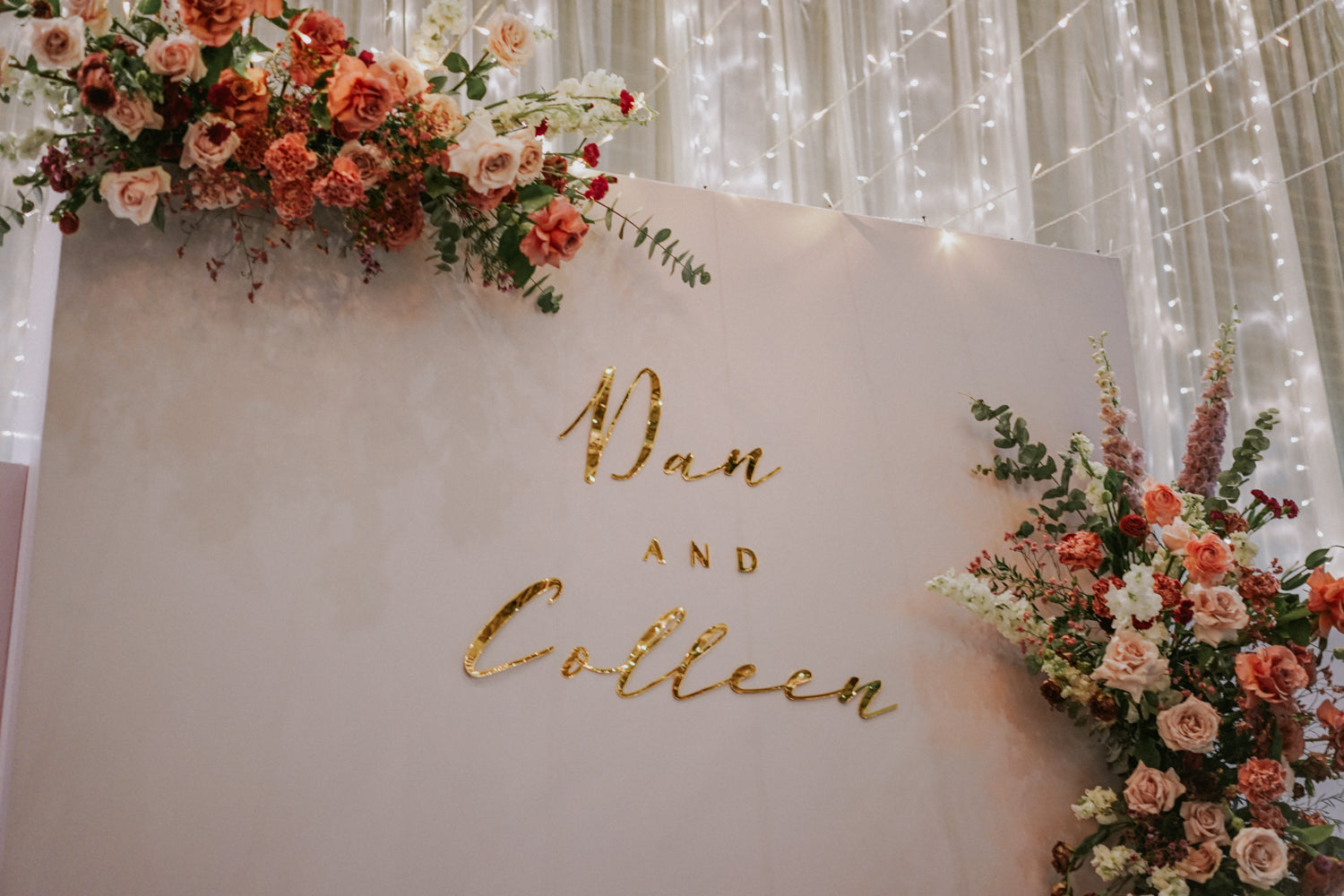 Blush pink colour palette for wedding with gold custom acrylic signs and fairylights at  PARKROYAL COLLECTION Pickering Hotel Singapore