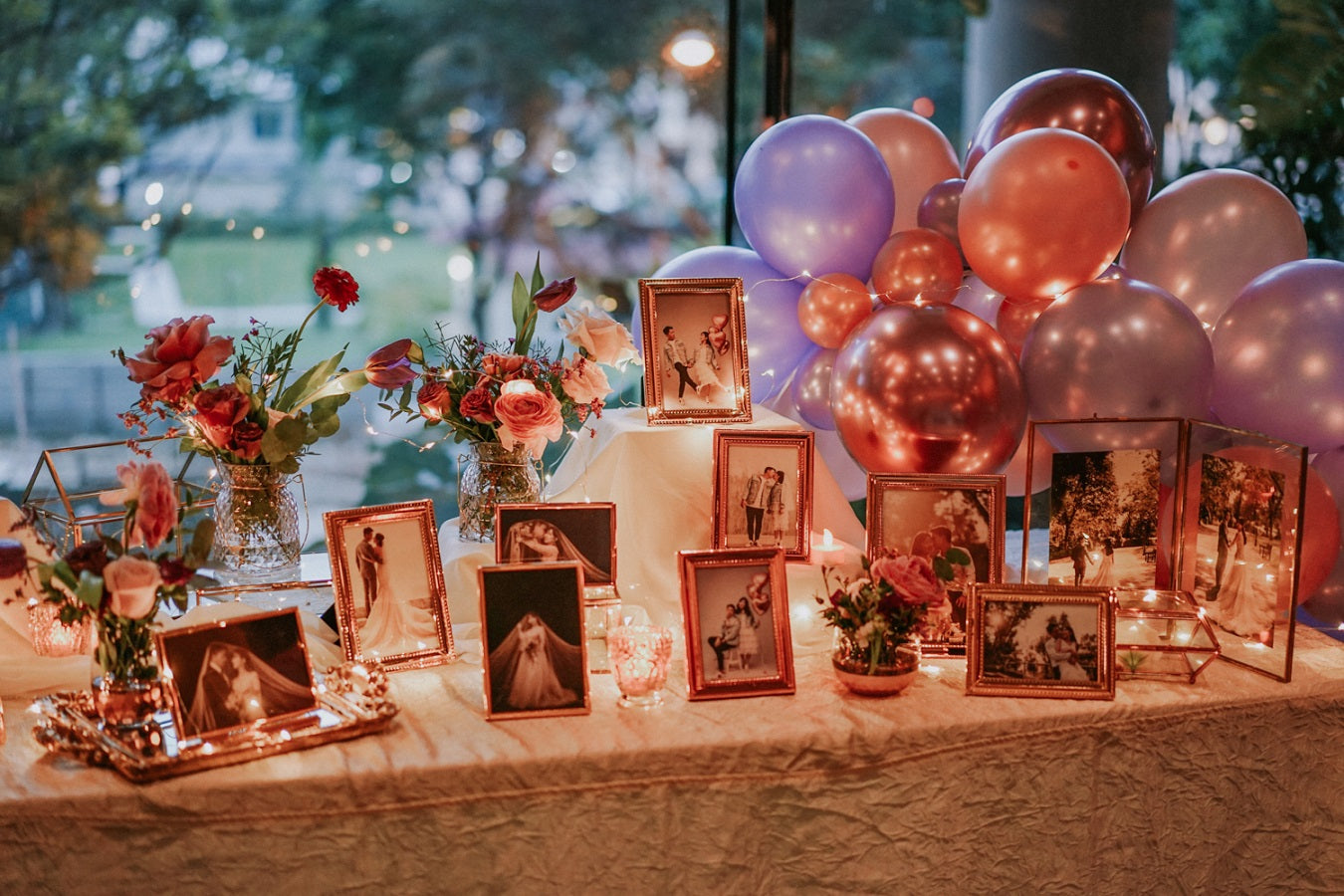 Pinterest worthy photo table styling at wedding reception with creative pre wedding photography and themed classy balloons