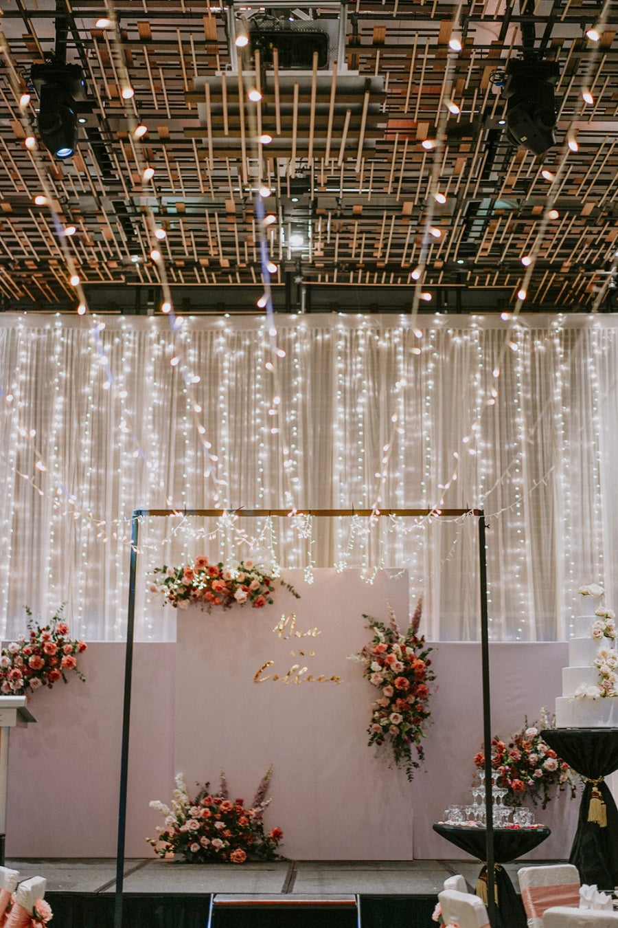 Cascading fairy lights strung on ceiling for whimsical events decoration as a wedding backdrop