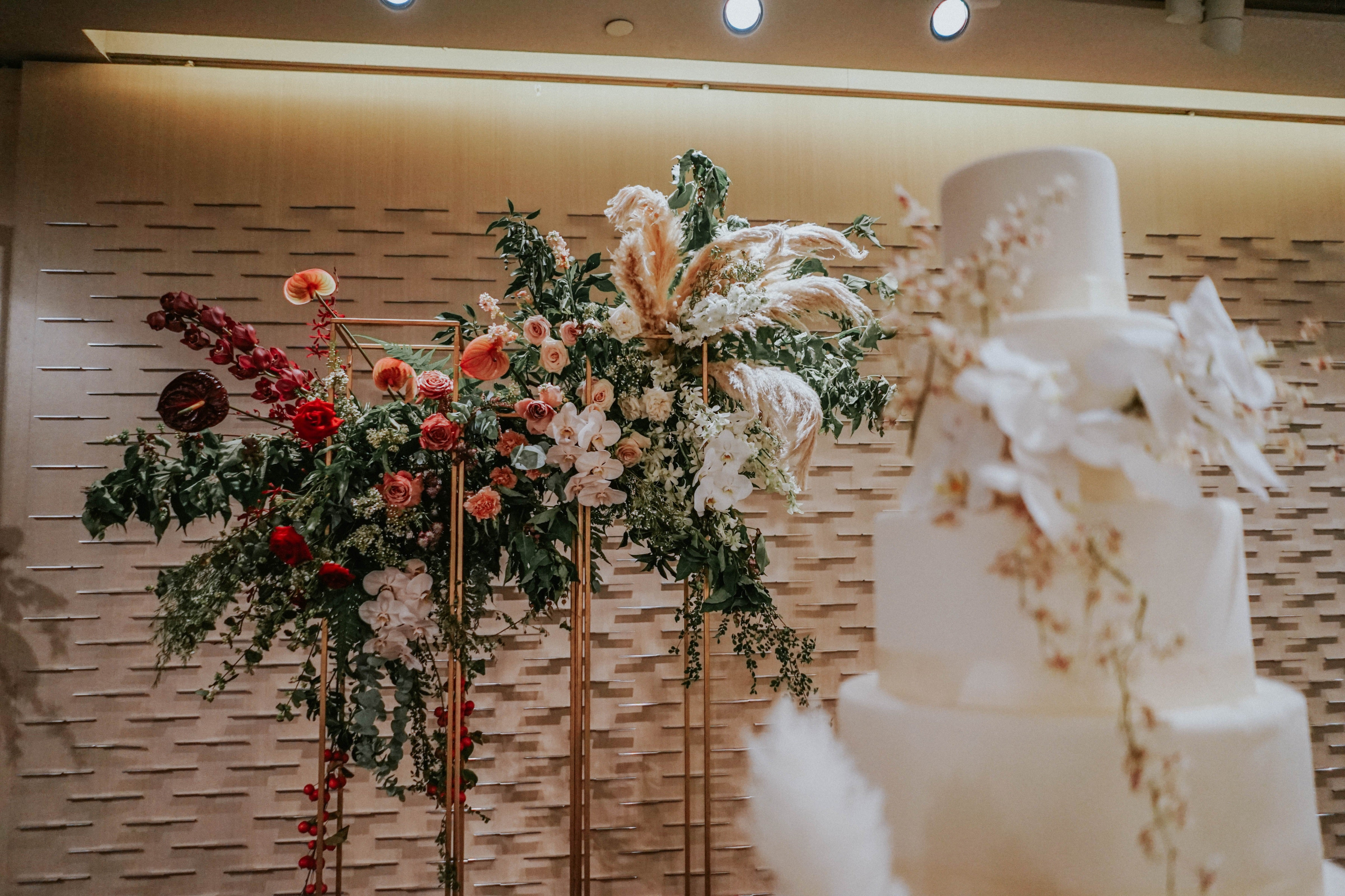 Red and dusty pink flower installation on rose gold standing structures on stage at Grand Hyatt Singapore Orchard Hotel