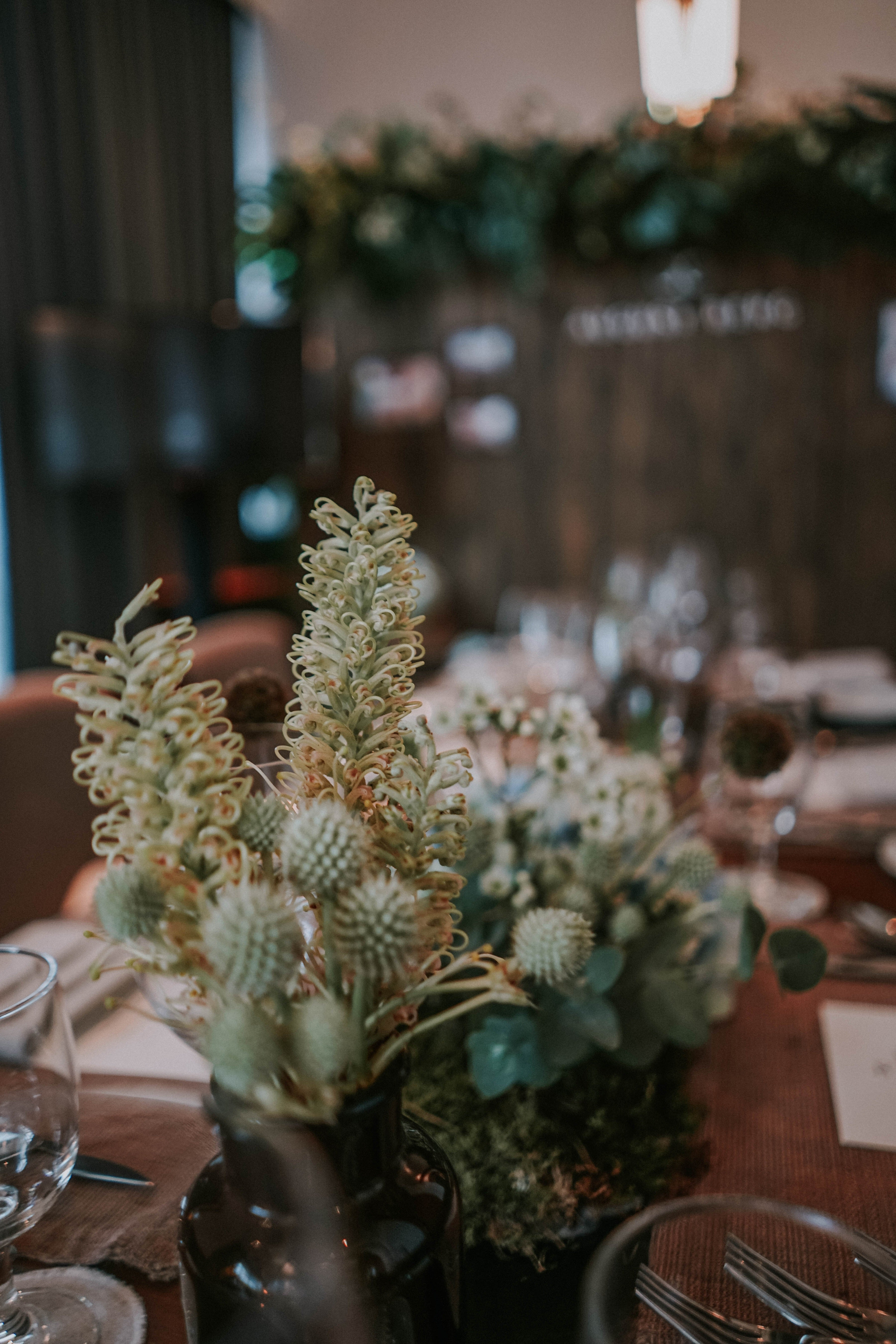 Close up of blue thistles and rustic flowers concept for corporate lunch idea
