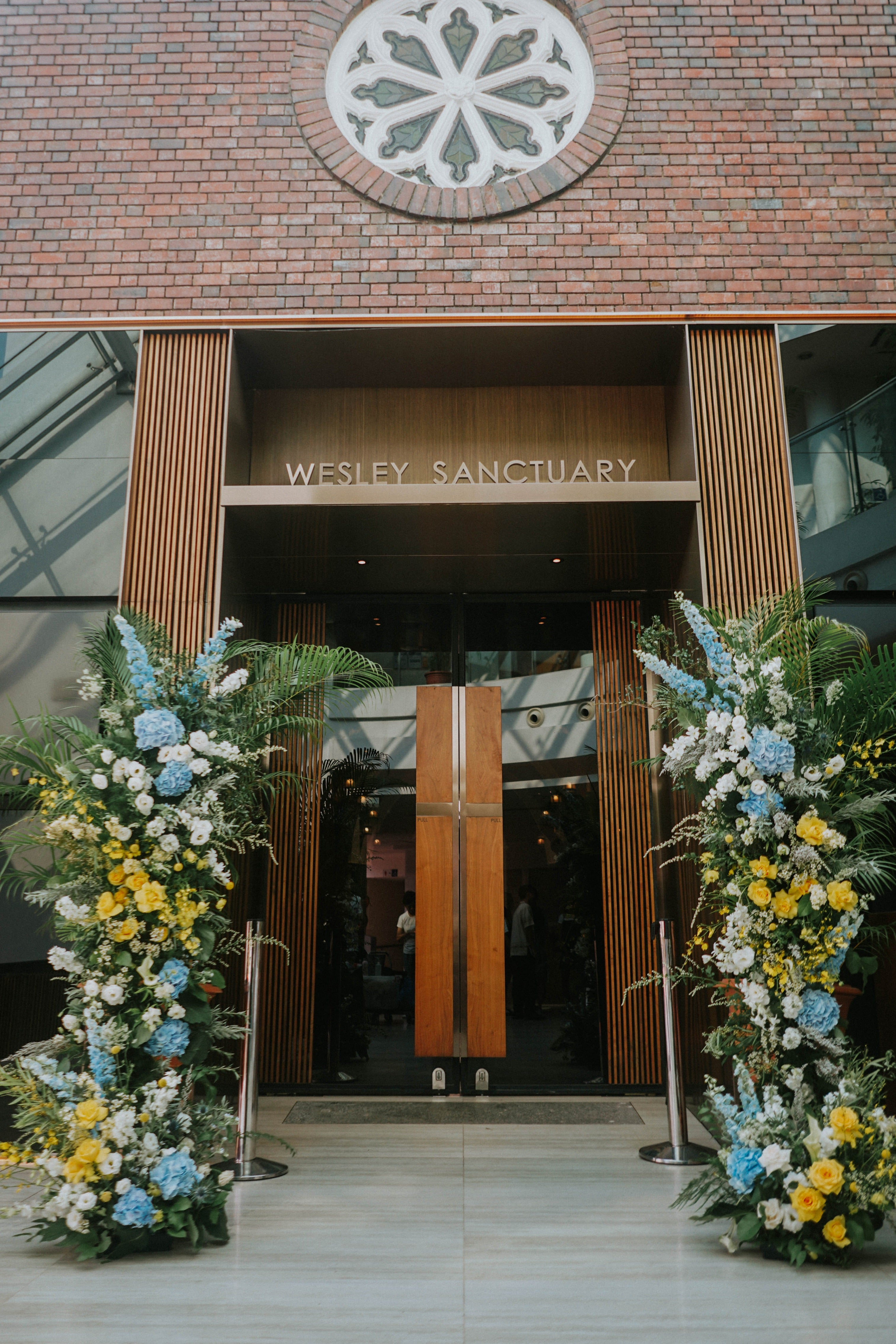Wedding floral pillars outside Wesley Methodist Church near Fort Canning Hill with yellow and blue colour palette